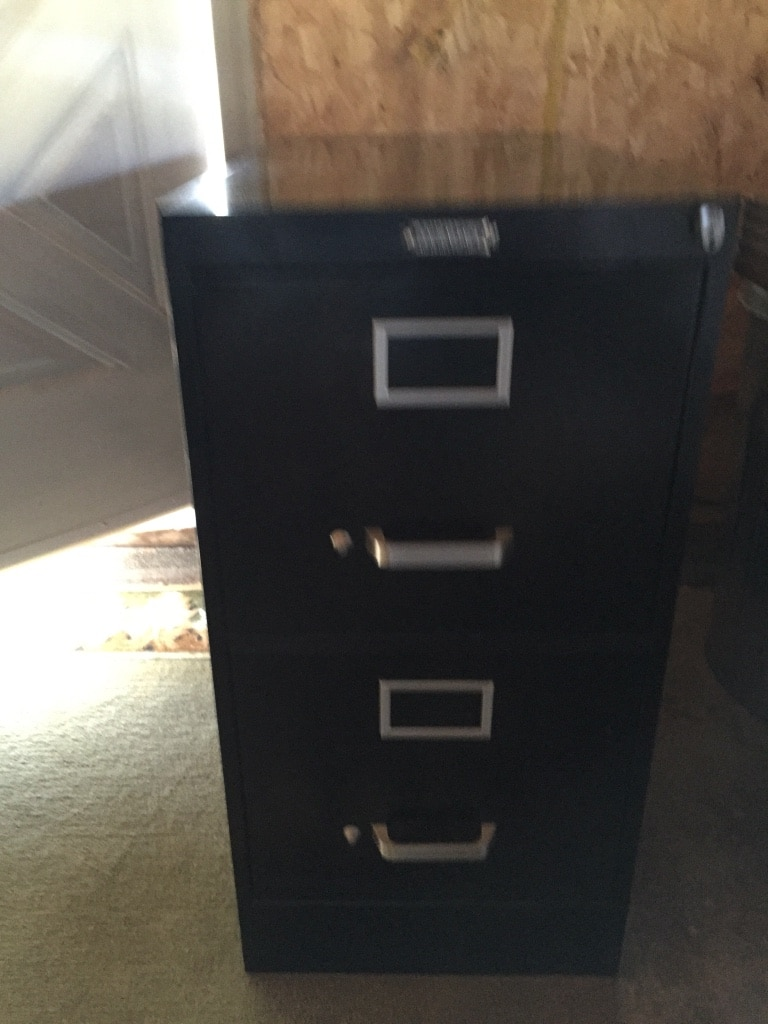 black metal three-drawer vertical file cabinet