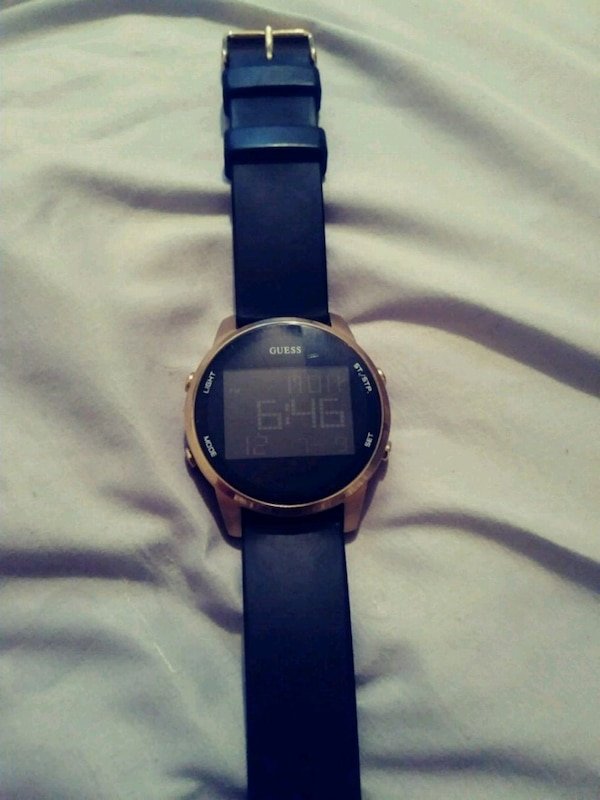 Bold In Black And Gold Digital Guess Watch