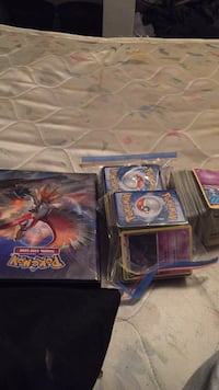 Pokémon 3 stacks and a book with ex's