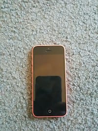 Pink iPhone 5c with wall charger and car charger