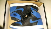 pair of blue-and-black Nike basketball shoes 2216 mi