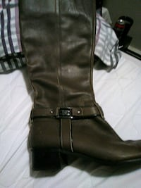 pair of black leather boots 2670 km