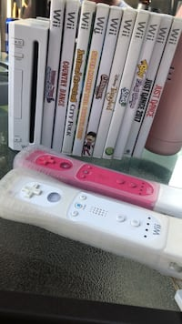 white Nintendo Wii console with controllers and game cases Ranson, 25438