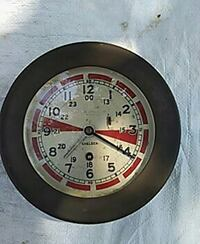 round silver and red analog wall clock
