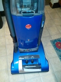 blue and gray upright vacuum cleaner Dayton, 45403