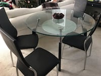 Round glass-top table with black steel base Silver Spring, 20906