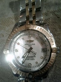 round silver, gold watch with link b and diamonds Edmonton