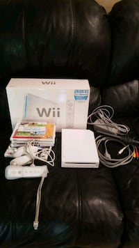 white Nintendo Wii console with controller and game case Placentia, 92870