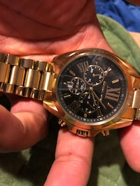 round gold-colored chronograph watch with link bracelet 254 mi