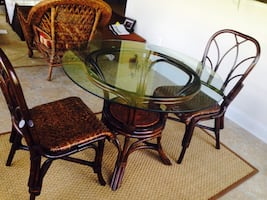 Pier one glass table and two wicker chairs. Excellent condition .