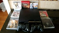 black Sony PS3 slim console with controllers and g Quincy, 02169