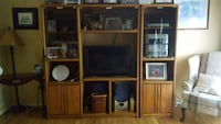 Brown wooden entertainment center  Springfield