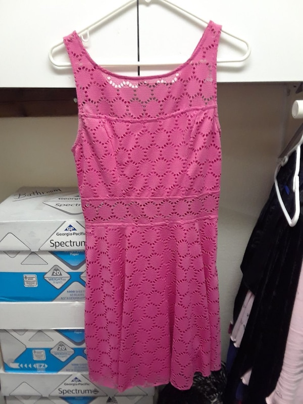 Pink lace short dress looks adorable on.