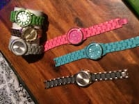 two round silver analog watches with link bracelets Lake Country, V4V 2G6