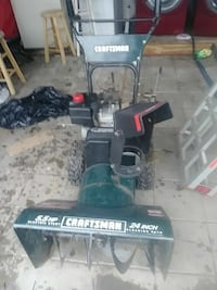 black and teal Craftsman snow blower