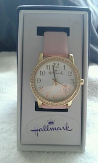 round silver analog watch with black strap in box