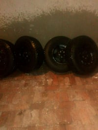 Set of 4 p235/7R15 tires with rims 5 lug