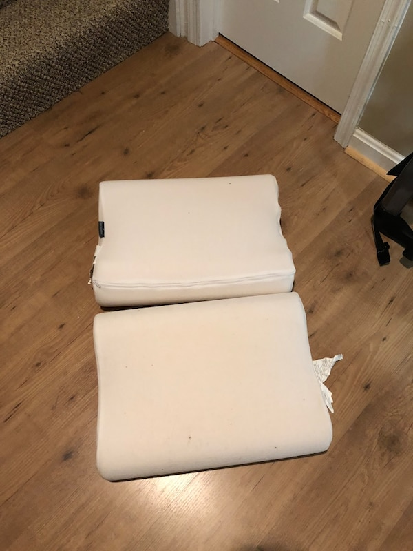 Two foam pillows with curve for neck support  f7782ac7-d0ce-449f-8897-155f0c754fd7