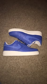 Pair of blue-and-white nike sneakers Flower Mound, 75028