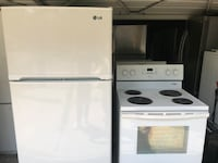 white top-mount refrigerator and induction range oven Redford