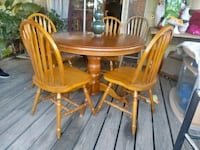 oval brown wooden table with four chairs dining set Hemet, 92545