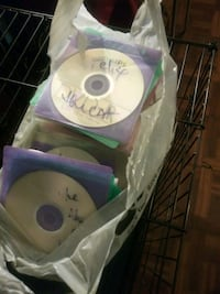bag of dubbed dvd movies and dishes