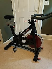 black and red Pro-Form stationary bike