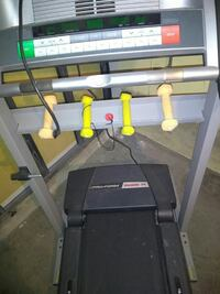 grey Pro-Form treadmill and two pairs of yellow-and-beige fixed weight dumbbells