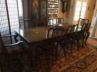 "Solid wood dining room table with 8 Chippendale chairs and 2 24"" leaves Rockville, 20850"