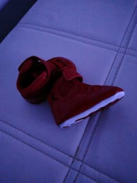 Baby red Jordans size 1 like new. Worn once. $20 sharp!