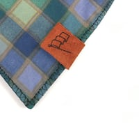 blue and brown plaid textile London