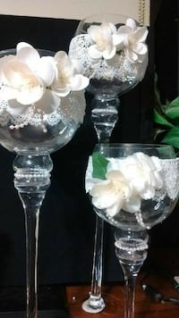 three  long-stemmed candle holders