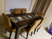 rectangular brown wooden table with six chairs din Silver Spring, 20904