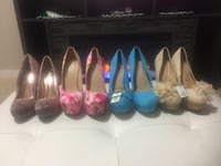 Four pairs of assorted colors of pumps. Some still new with tags