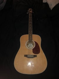 brown and black acoustic guitar South Lyon, 48178