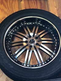 gray multi-spoke auto wheel with tire 58 km