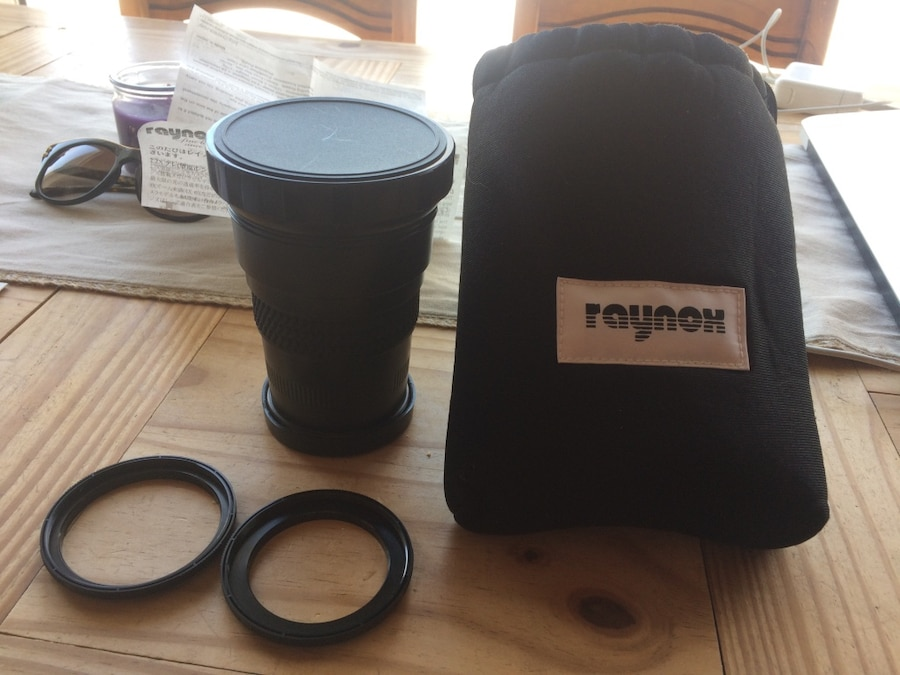 black Raynox telephoto lens with bag for sale