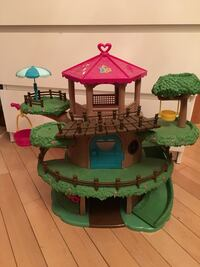 brown, green, and red plastic tree house toy 787 km