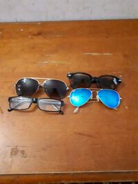 two black and blue framed sunglasses Montréal, H4J 2J2