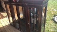 brown wooden framed glass display cabinet Charles Town, 25414