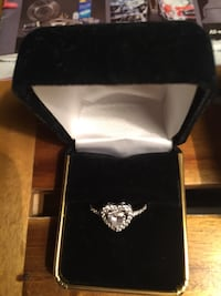 Ladies Sterling silver moissanite, heart ring. Marked/stamped inside shank 925.. Sz.9. I removed the ring guard , brand new!. B.R.O. Takes it. Boston, 02118