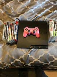 black Sony PS3 slim console with controllers and game cases Calgary, T2A 2E6