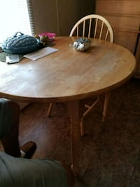 round brown wooden table with four chairs dining s Fairmount, 30139