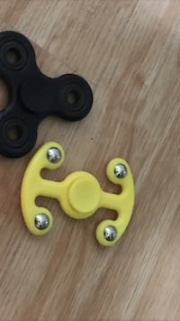 black and yellow hand spinners