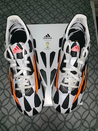 pair of white-and-black Nike cleats 558 km