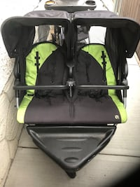 Black and green twin stroller 300.00or offers or trade Edmonton, T5P 2B2