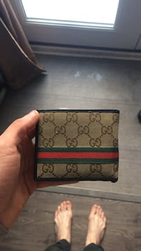 men's monogrammed brown, green, and red Gucci bi-fold wallet