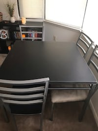 rectangular black wooden table with four chairs dining set 26 km