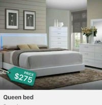 white bed frame with gray bedspread