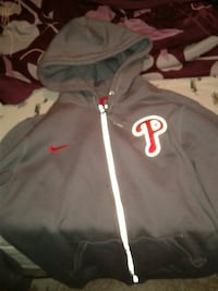 grey, white, and red Nike zip-up hoodie